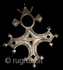 Bartchakea Tuareg Cross,  silver hand made amulet from Niger, region of Bartchakea. On the back side a sign represents artisan signature Tuareg crosses are mostly worn by men and they are handed  ...