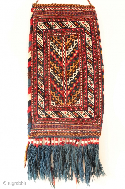 A superb soumak technique Afshar spindle bag, with a tree of life motive in the front and a diagonal striped motive at the back. As it is the case in many spindle  ...
