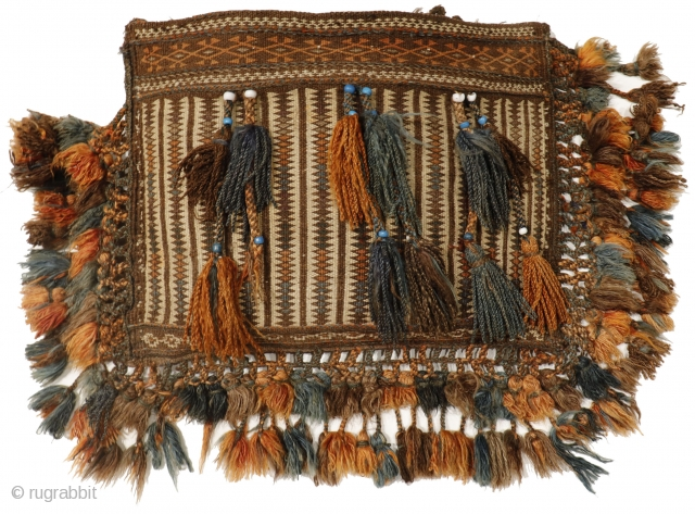 This chantah or bag is finely woven with the kilim technique and profusely decorated with a multitude of pompoms, and blue and white beads (protection against the evil eye). In perfect state  ...