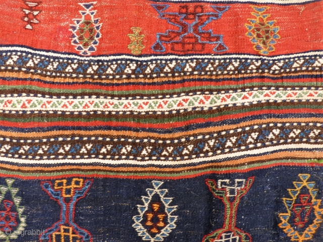A beautiful Qashqai kilim that originally was a large bag. All the dyes are natural, including a beautiful green and mustard yellow. Very finelly woven. And yes, we know, it is not  ...