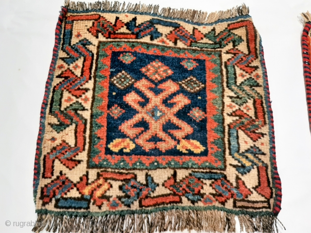 """Pair of piled Luri saddle bag or """"khorjin"""" faces, in very good condition, natural colours: green, light and dark indigo blue, yellow, undyed white and brown, terracotta, primitive design, new overbinding to  ..."""