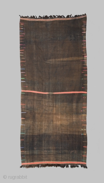 """Woman's mantle """"Backhnug"""" cod. 0405. Wool cotton. Berber people. Matmata area. Tunisia. Early 20th. century. Good condition with several small holes. Backed with a brown cotton fabric and mounted onto a wooden  ..."""