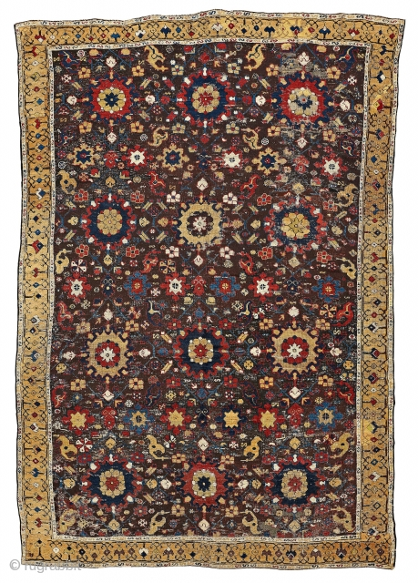 18th Century Karabagh carpet. It has been shorten and have lot of wear and tear, repairs, re-knottings etc.   Ca 3x2 Meters