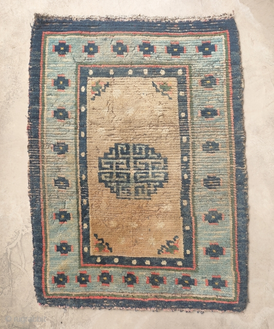 antique tibetan saddle top with a rare border.not in perfect condition. need a good bath.
