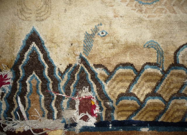 very rare and exceptional fragment of a chinese transitional imperial carpet.the field design was executed in the tradition of the ming era palace carpet. the large scale main border with lotos flower  ...