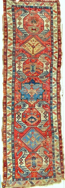 Extraordinary and whimsical Shahsavan long rug from the Moghan plain. Marvelous color. Reasonable condition. Mid 19th c. or older. Recently returned. Just professionally cleaned.