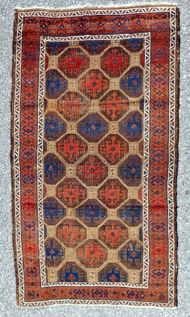 Uncommon Baluch rug with a distinctive Memling gul lattice. Turkish knotted. Splendid color with true camel. Good condition. c. 1870.