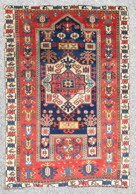 Classic Mid 19th c. Fachralo Kazak prayer rug with exceptional drawing and color. Reasonable, original condition with some issues. Good pile.
