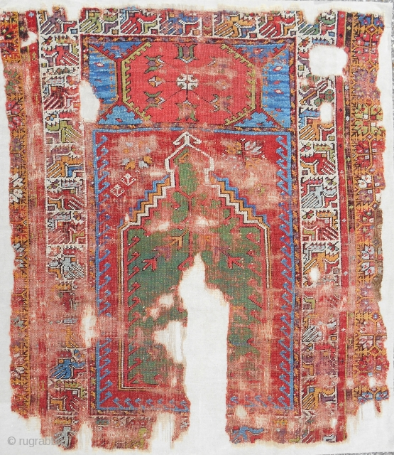 Small and bold 18th c. Mudjar prayer rug. Best color! Conserved and expertly mounted on linen.
