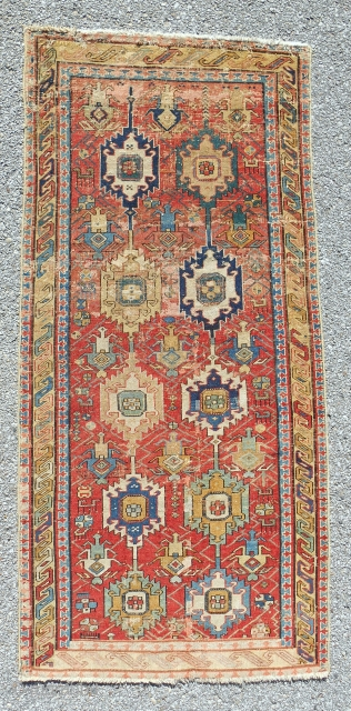"""Circa 1800, small (only 32""""x 68""""), distinctive """"linked palmette"""" classical Caucasian rug with some old faded repair. Just cleaned. Cool and rare!"""