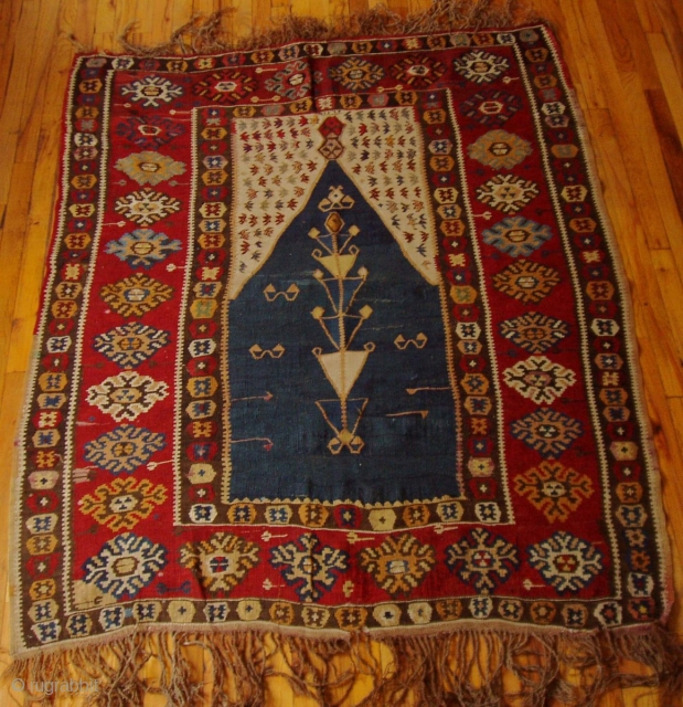 """Erzerum Prayer Kilim  Provenance:  Northeastern Anatolia  Dimensions:  4'10"""" x 5'7"""" (151 cm x 174 cm)  Dated (woven into top of mihrab panel) 1292AH (1875)see detail photo  Excellent condition"""