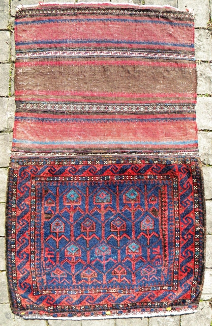 Baluch khorjin half (with back); excellent pile, soft glossy wool, overall good condition as shown in the images, no repairs, natural colours; 92 x 57 cms.