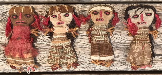 Four rag dolls, Afghani or Pakistani, made of various coarsely woven fabrics, twigs used to strengthen hands and feet, some of which are broken; probably mid-20th century; remarkable that these have survived  ...
