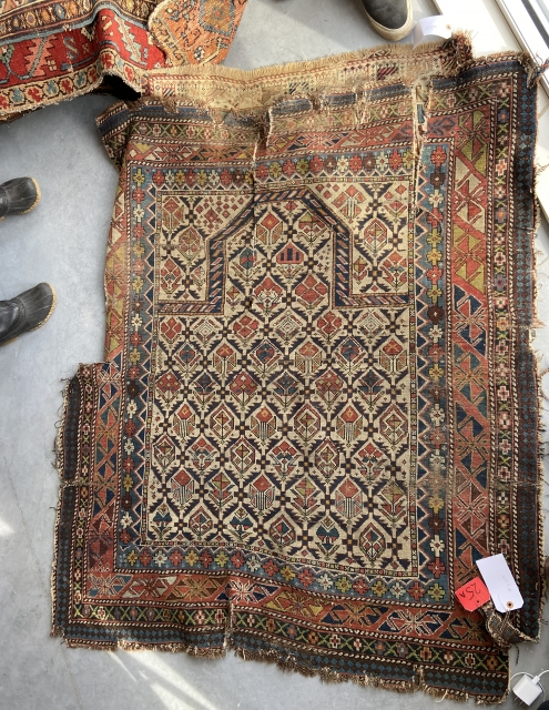 """early 19th  century Shirvan prayer rug from a notable collection, which will be offered post cleaning """"as is""""."""