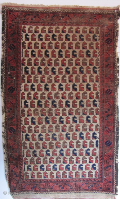 "A quirky Baluch with extremely rare ""monkey wrench"" design (or are they animal heads? or chess pieces?). Open right on a handspun-cotton foundation. 19th century. 140x87cms"