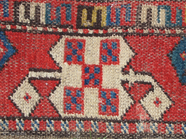 "Kirghiz piled tent-band fragment. Single wefted. Wool. Faint traces of color run on back. 6'3""x 0'7.5"""