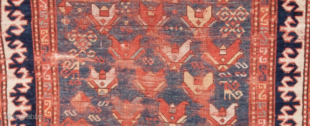 """A rare """"Kazak-type"""" rug with an east Caucasian field design. The field color, neither green nor blue and hard to capture in a photo is unusual and appealing. The powerful, reciprocal border  ..."""