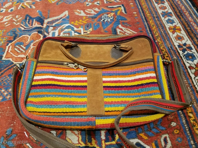I am sorry if you a bother. This is not a collectible item Got this in Shiraz and never used it. A computer bag in suede and lovely Qashqai kilim face    75 euro  ...