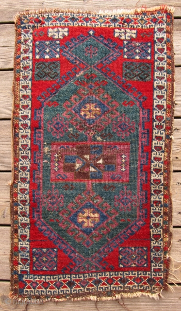 E. Anatolian yastik, 2nd half 19th C.  Deep green, surrounded by a rich cochineal background, make this a very powerful color statement. Older than most, the drawing is in keeping with  ...
