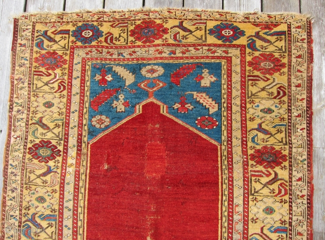 "Ladik Prayer Rug, 1st Qtr. 19th C.3'5"" x 5'4""An early Ladik prayer rug., circa 1800, with an unusual treatment of the mihrab. The customary stepped sides of the arch have been simplified  ..."