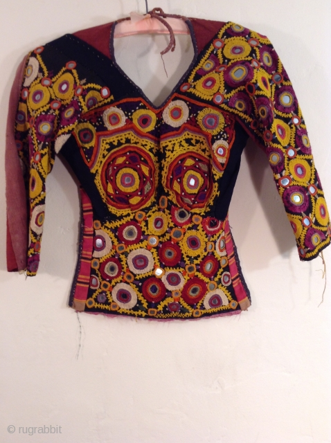 This is a Choli from India.  It is in excellent condition with over all embroidery and mirror work.  It is about a size small to medium.
