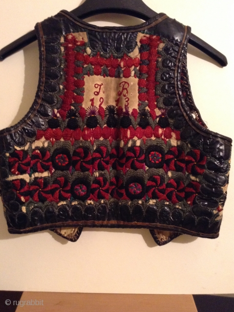 I believe this is an Hungarian or Transylvanian vest, but I am not positive.  It is embroidered on leather and  still has some of the fur lining. There are slight damages  ...