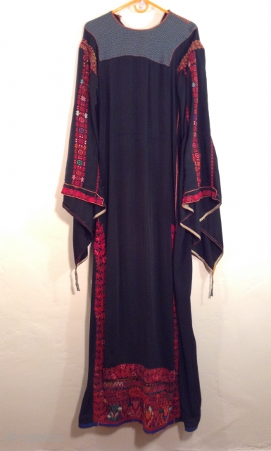 This is a Palestinian dress stemming from the 1930s.  It has been embroidered on the original black fabric and remains in very good condition.  It has been carefully handled in  ...