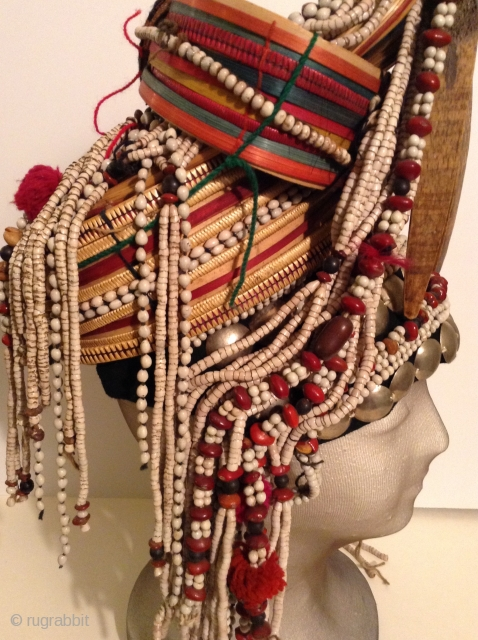 Akha Hilltribe Woman's Hat, either from Thailand or Burma. Woven Bamboo, rattan, seeds, metal beads, glass beads, shells, cotton.  18 inches long and 8 inches wide. Perfect condition.     .