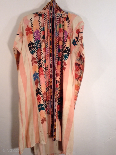 This is a Chirpy from Uzbekistan.  It is in very good condition although there is some slight running of a pink color and a blue color. It dates from the early to  ...