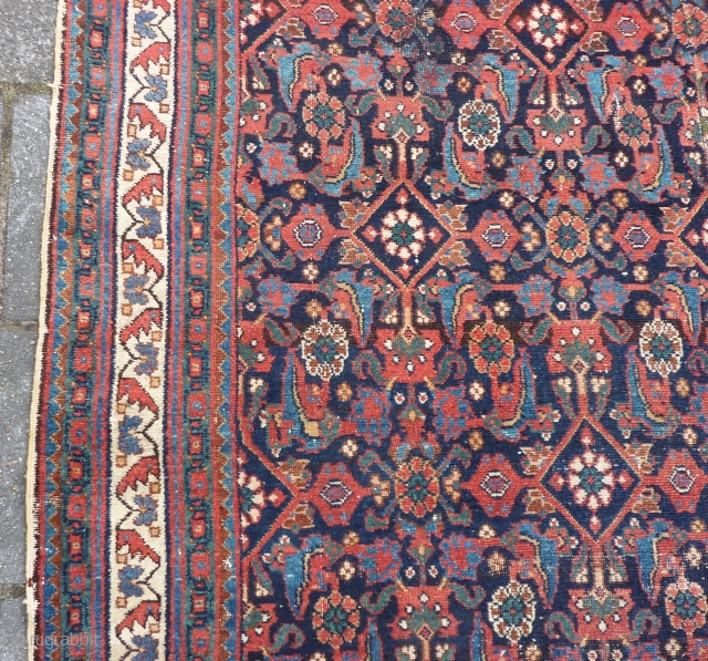 """Afshar herati rug, 233  x 170  cm., 7'8"""" x 5'7"""", ca. 1900, with great, saturated colours. With wear and a kind of repaired 3 feet long slit (?) in the  ..."""