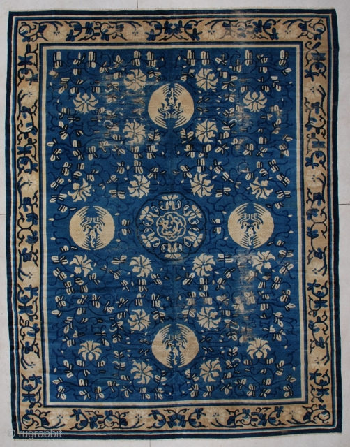 """#6232 Very Antique Peking Chinese  This Peking Chinese rug measures 8'10"""" x 11'5"""". It has a dark blue to indigo vine design with ivory flowers completely covering the light blue field. The  ..."""