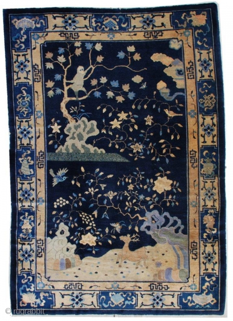 """#7184 Antique Peking Chinese Rug  This circa 1910 Peking Chinese Oriental rug measures 6'1"""" x 8'10"""". It has a navy blue ground with a single motif.  There is a large silver  ..."""