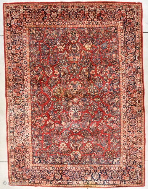 """Antique Sarouk Persian Rug 8'8"""" X 11'9"""" # 7989 This circa 1920 Sarouk measures 8'8"""" X 11'9"""". It has an overall floral design which is very nicely drawn on a very happy ruby  ..."""