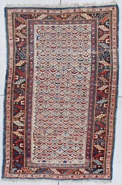 """#6160 Kuba Antique Caucasian Rug 3'5″ X 5'4″ This circa 1880 Kuba antique Oriental Rug measures 3'5"""" X 5'4"""". It has a lattice design containing different colored flowers on an ivory field. The  ..."""