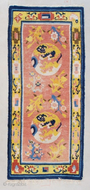 """#7508 Antique Ningxia Rug  This circa 1850 Ningxia antique Chinese rug measures 2'5"""" x 5'4"""" (76 x 164 cm). It has a coral ground containing two ivory medallions which contain two wrestling  ..."""