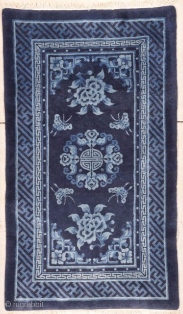 """#7766 Mongolian Rug  This circa 1940 Mongolian Chinese Oriental handwoven rug measures 3'5"""" X 5'10"""". It is woven in three colors of blue and ivory. The center medallion consists of a 'Shou' symbol  ..."""