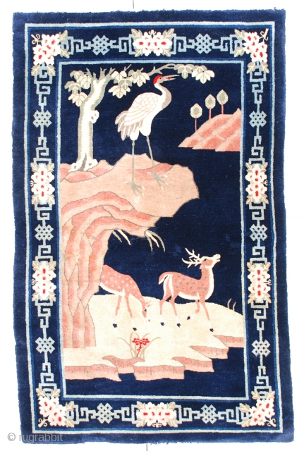 """#6688 Antique Mongolian Rug This circa 1940 Mongolian rug measures 4'0"""" x 6'2"""". It has an idealized animal scene with a red headed crane on a cliff overlooking two grazing deer in a  ..."""