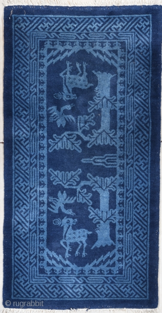"""#7767 Mongolian Rug  This circa 1940 Mongolian Chinese Oriental handwoven rug measures 2'4"""" X 4'7"""". It has three colors of blue. There are two deer and two ducks beneath trees in the field.  ..."""