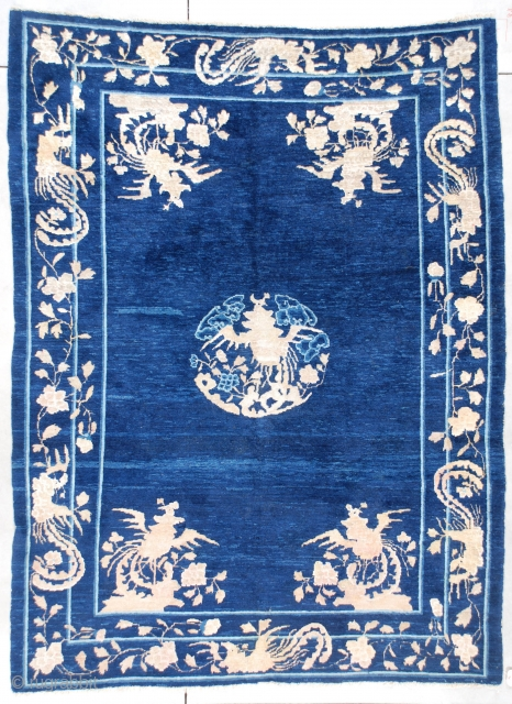 """This late 19th century Peking Chinese Oriental Rug measures 6'4"""" x 8'5"""". It has a dark blue variegated field with a corner motif of phoenix birds perched in a tree growing out  ..."""