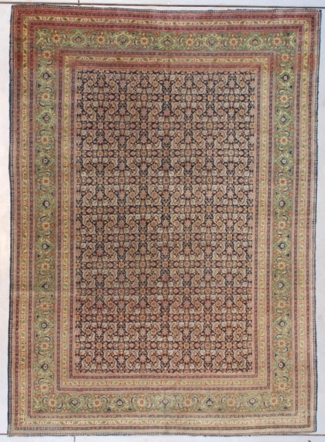 "This circa 1890 antique Fereghan Sarouk Oriental Carpet #7631measures 5'9' X 8'0"" (179 x 243 cm). It has a beautifully drawn Herati motif in pale blue and rust on a dark blue  ..."