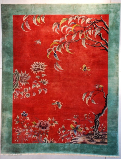 """This circa 1920 Art Deco Chinese Oriental #7632 rug measures 8'7"""" X 11'4"""" (267 x 347 cm). The motif is absolutely fantastic! Growing out of a rockery in the lower right corner  ..."""
