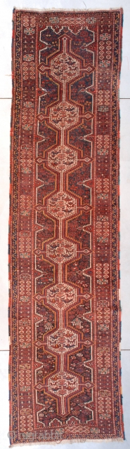 """#7402 Shiraz Runner  This first-quarter 20th century Shiraz runner measures 3'6"""" X 13'10"""" (109 x 422 cm). It has eight ivory medallions containing birds and various quadrupeds on a dark blue ground which  ..."""