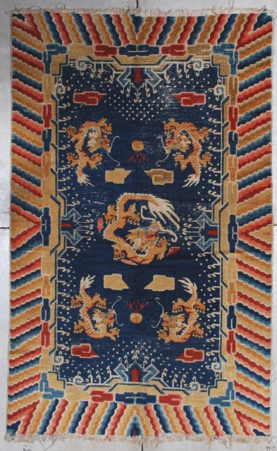 """#7118 Antique Ningxia Chinese Rug 4'4″ x 7'0″ This late 19th century Ningxia measures 4'4' x 7'0"""". It has a navy blue ground with five dragons in yellow gold. There are cloud  ..."""