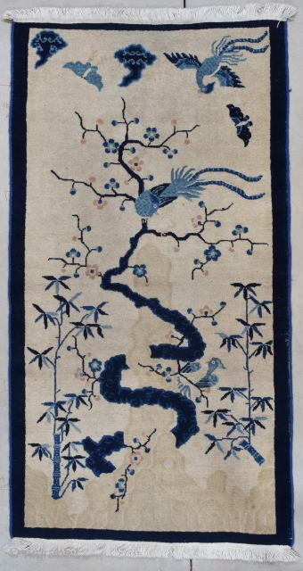"""#7743 Peking Chinese Rug  This circa 1910 Peking Chinese antique rug measures 3'1"""" X 5'10"""" (94 x 180 cm). It has bamboo growing up the sides of the field flanking a twisty tree  ..."""