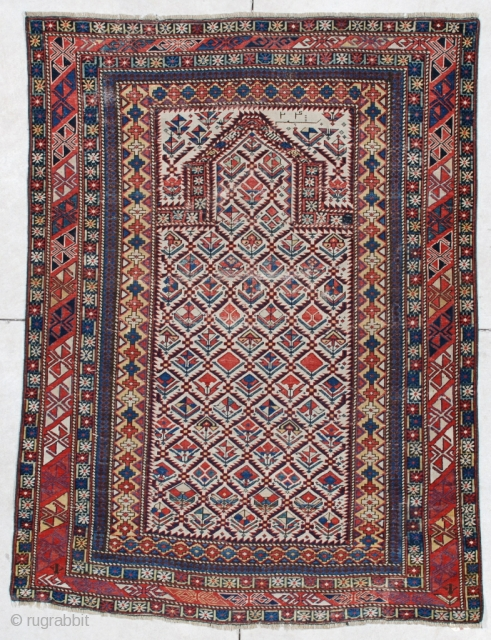 "#6091 Marasali Shirvan This Marasali Shirvan rug measures 4'0"" x 5'6"". It has a prayer design on an ivory field with a lattice design. Each opening in the lattice has a different  ..."