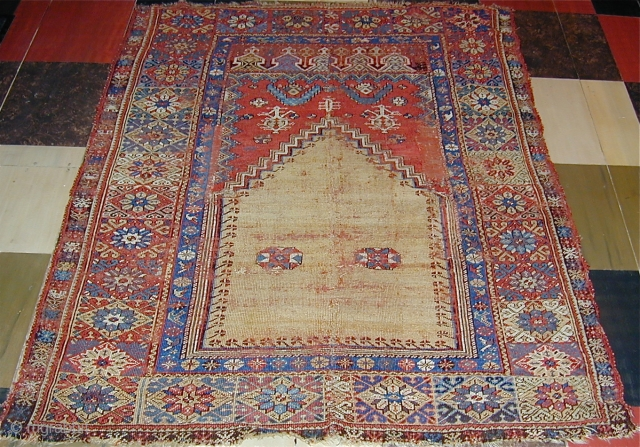 Mudjur prayer rug vertically cut and sewn back together  (see detail..Approx 2'' missing),65'' X 48''(165 X 123cm.), 18th. century.