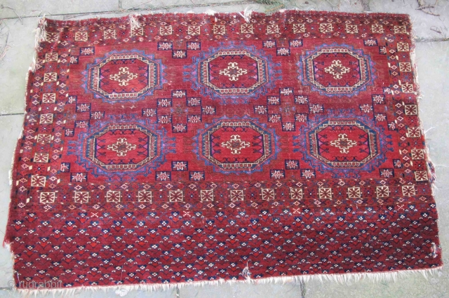 Tekke turreted gul chuval, circa 1800, finely woven with pashmina wool, elegantly highlighted with jewel-like corrosive crimson insect dyed wool and crimson silk: an unusual piece showing very round guls. Most Tekke pieces with  ...