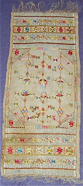 Silk embroidered textile on linen with open work,some staining, India, 30'' X 12''.
