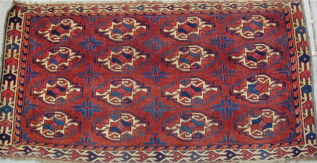 Archaic Yomut Chuval with wonderful colors including lots  of corrosive insect dye highlights throughout the piece, finely woven with good pile, luminescent wool, and a pepper and salt back, Ca. 1800, 42''X 22''
