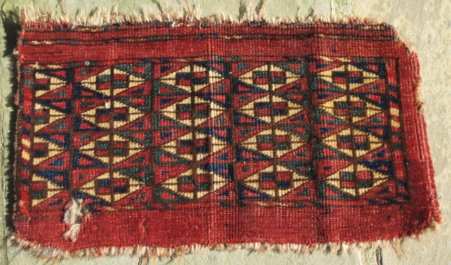 Finely woven Yomud Kap, missing narrow solid red border on one side, small hole(easily repaired), 19th. century, 15'' X 8'' (38 X 23 cms)